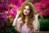 beautiful girl near a flowering bush