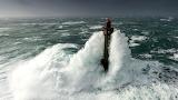 Lighthouse in storm waves, Ushant Island, France