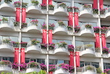 Facade, balconies, windows, flowers, flags, architecture