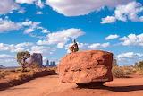 Monument-valley-navajo-indian-desert-rocks-man-sitting-watching