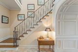Staircase with Staggered Artwork up Wall