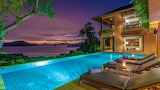 Luxury mansion and pool at night in Phuket