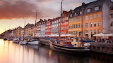 Colorful homes line Nyhavn Canal in Copenhagen, Denmark 20130605