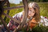 young girl behind cart wheel