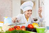 Happy-professional-cook-in-white-workwear-works-in-comm