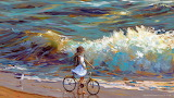 girl biking on the beach
