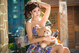 Asian woman, sitting, teddy bear, bench