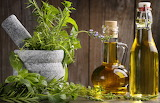 Herbs And Two Bottles Of Oil