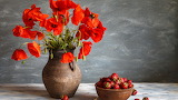 ^ Red poppy flowers, vase, a bowl of strawberries