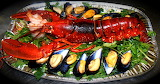 ^ Lobster with mussels