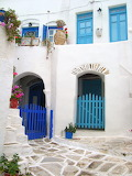 Various small 157 white houses and flowers Greece