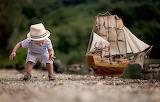 Boy, toy ship, child, hat, nature