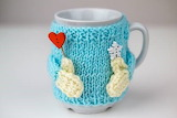 Cup wearing a sweater
