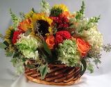 ^ Flower arrangement with sunflowers, snapdragon and hydrangeas