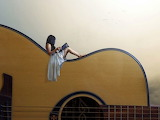 Lady on guitar
