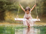 ^ Swinging over water
