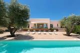 Modern white Mediterranean villa and pool
