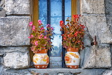 Vases, flowers, window, stone wall