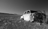 Abandoned car in black and white