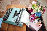 Old typewriter, desk, flower bouquet