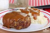 ^ Hamburger steak, mashed potatoes with gravy