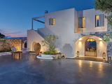 Beautiful modern Greek villa at sunset
