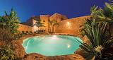Luxury old stone villa courtyard pool at night