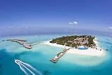 Small Island and Huts Over Ocean Maldives Islands