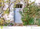 Old-door-overgrown-rose-bush-white-wood-quaint-little-french-hou