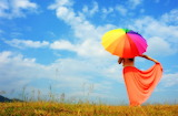 Young Woman With Rainbow Umbrella