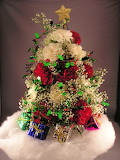 ^ Christmas tree flower arrangement with presents