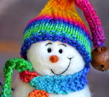 Snowman with colorful hat and scarf