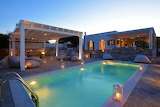 Luxury white villa at sunset in Paros, Greek islands