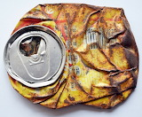 flat rusty tin can