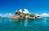 Small Rocky Tropical Island with Coconut Palms
