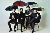 The Beatles with umbrellas