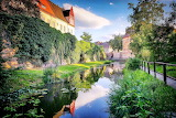 Castle, walls, moat, water, reflection, park, trees, fence