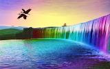 Bureaublad-achtergrond-met-waterval-in-alle-kleuren-van-regenboo