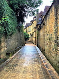 French village alley after rain shower