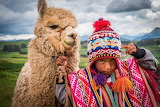 Andean child with his lama