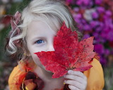 Girl with a red leaf