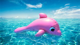 Pink toy whale at sea