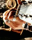 Picking guitar strings