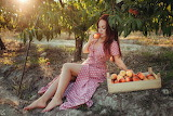 Girl eating peaches