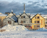 City-old-houses-winter-snow-Finland