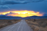 Gravel road to mountains and sun Montana