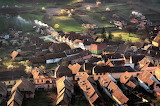 Morning sun rooftops of Romanian village in the spring