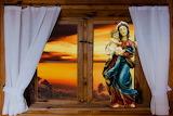 Window-Mary-Jesus-curtains-sunset-statue