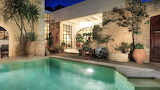 Rustic style Mediterranean villa, and pool at night