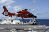 Coast Guard helo landing on Navy Hospital ship